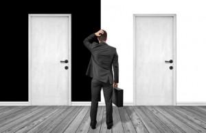 man standing in front of doors / Black / White
