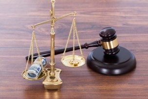 Gavel And Scales With Money On Desk